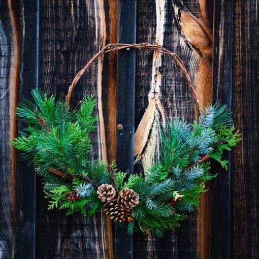 half evergreen grapevine wreath