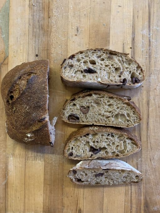 Olive and Polenta Rustica An organic sourdough free form loaf of bread, whole grain with kalamata olives (not organic) and organic polenta.