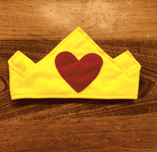 gold crown with red heart