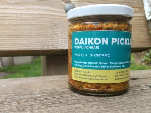 jar of daikon pickle mix with label of ingredients and contact info